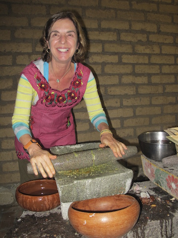 In Oaxaca - making mole... no electricity, surrounded by chickens running around ... but we make the MOST delicious food!